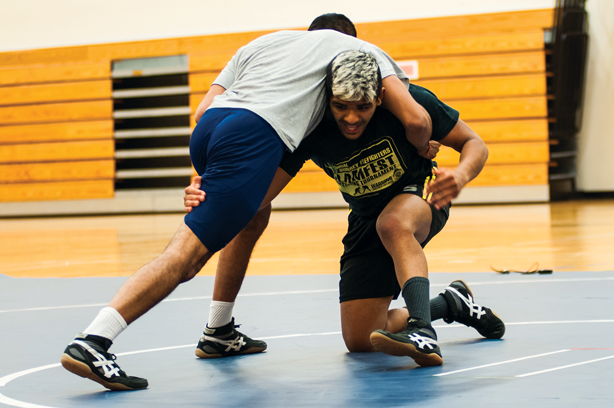 Coach Raj Virdi shows Jaskarn Ranu a thing or two about takedowns.