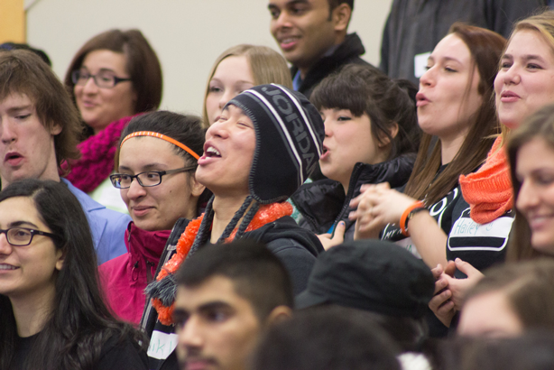 New students embrace the atmosphere that filled the gym at orientation.