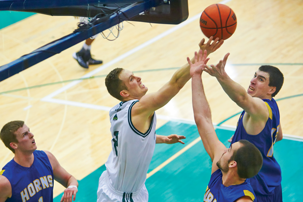 Jasper Moedt's towering strength went head to head against the Pronghorns' powerful offense, leading UFV to a two-game playoff sweep. (Image: Tree Frog Imaging)