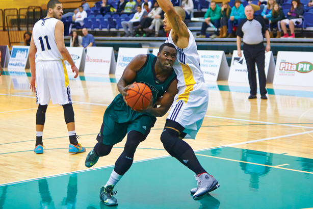 The men's basketball team faced a particularly formidable opponent in the Brandon University Bobcats. (Image:  Tree Frog Imaging)