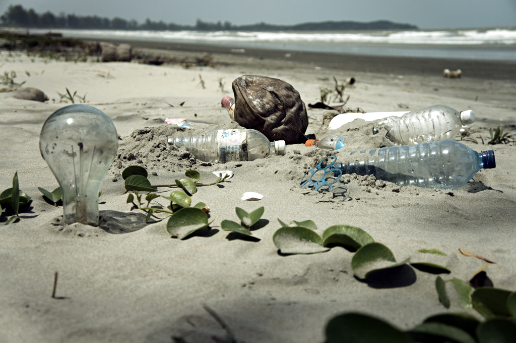 Discarded plastic on beaches has become a whole new substance unto its own: plastiglomerate. (Image:  epSos.de/flickr)