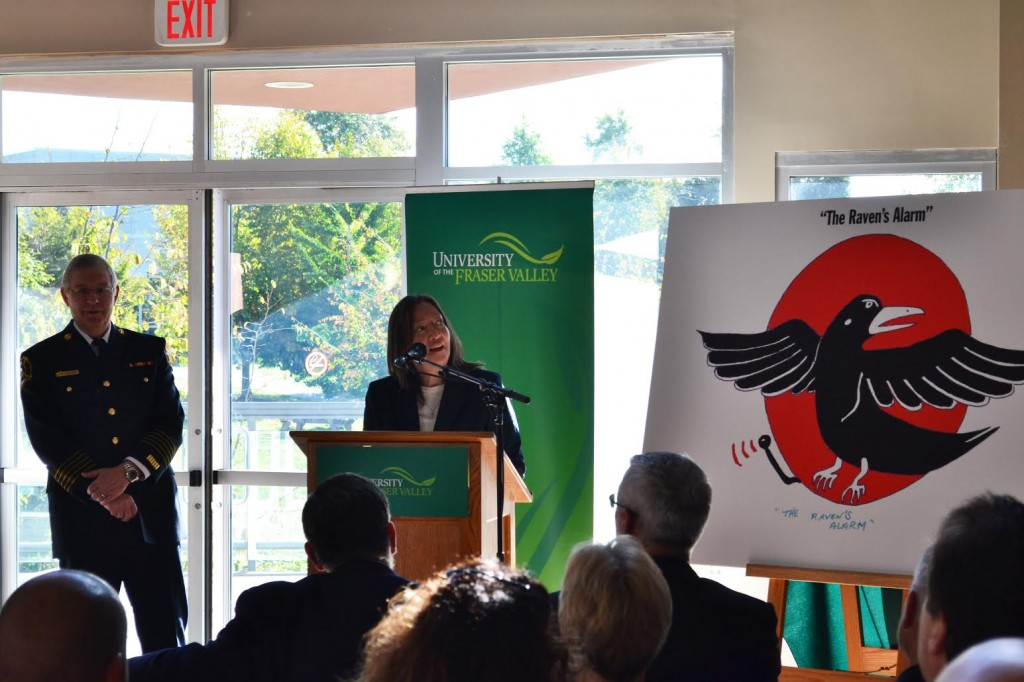 """""""The Raven's Alarm,"""" a painting by Stephen Point, was unveiled by Gwen Point at the ceremony as the fire prevention campaign's logo. (Image:  Valerie Franklin)"""