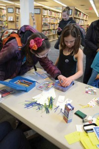 Kids had the opportunity to customize their own bookmarks at one of several arts and crafts tables set up in the library.  (Image: Valerie Franklin)