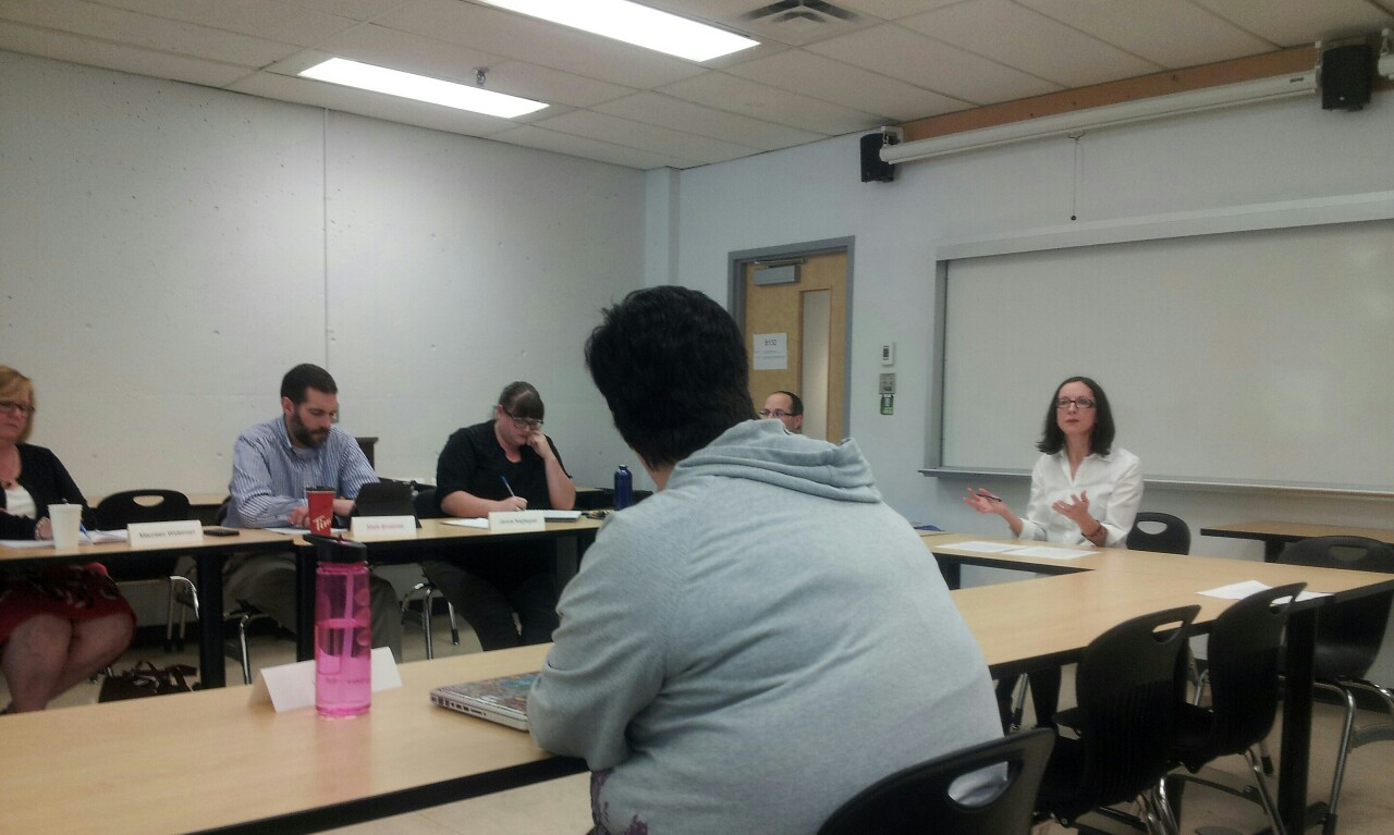 Gloria Borrows (far right), a Writing Centre faculty member, fielded questions for almost half an hour at an open meeting of the APPC.