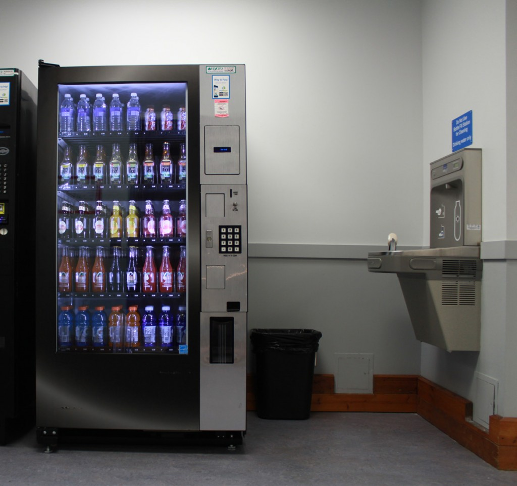 vending machine on the left with water fountain on the right.